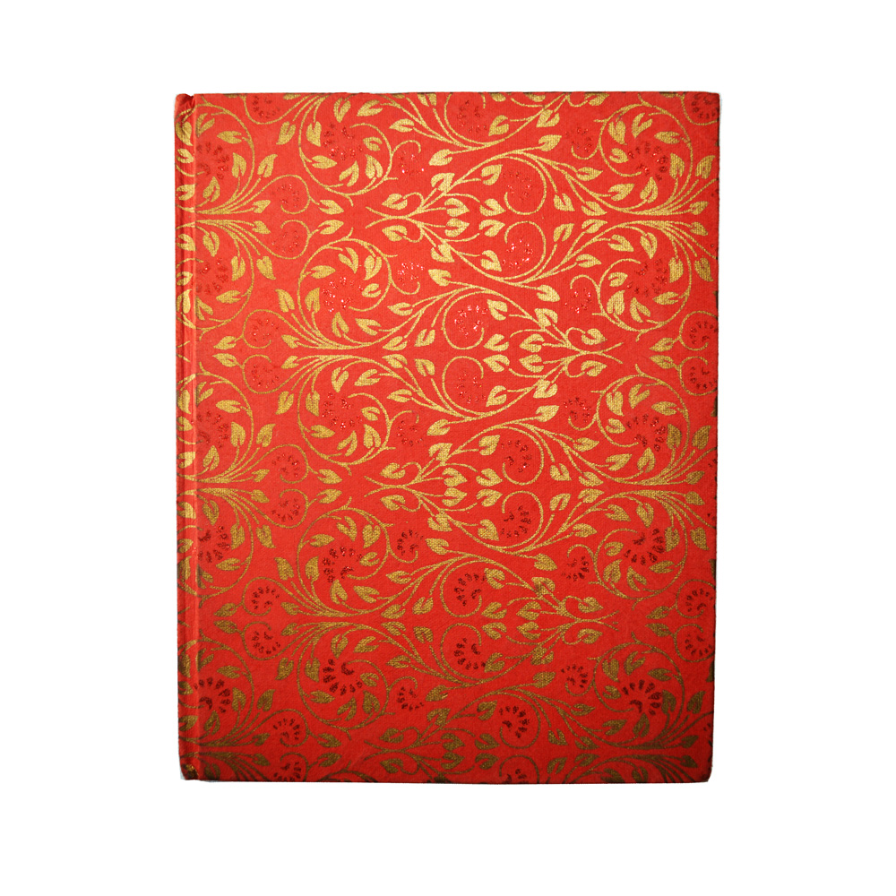 Floral pattern in gold print notebook with reddish background