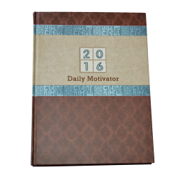 Brown hard cover business diary with motivating stuffs